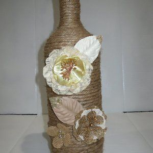 Jute wrapped XL wine bottle/vase. Burlap flowers .